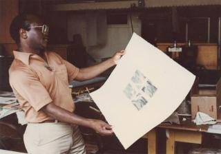 Leon Hicks looking at a print