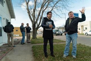 Ron Beals and Xiochen Hu talk while standing in a residential area