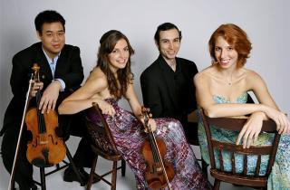 members of the Linden String Quartet sitting on chairs
