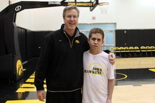 Coach Fran McCaffery stands alongside REACH student Danny Tyson