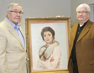 Jack and Mick Sharer, with portrait of their sister, Teresa (Sharer) Benoit
