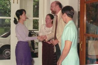 McMullen shaking hands with democracy leader Aung San Suu Kyi in Rangoon, Burma.