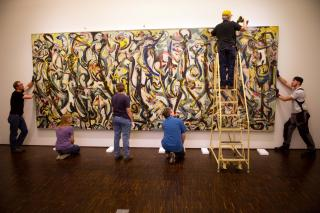 Workers remove Mural from the Figge Museum earlier this year