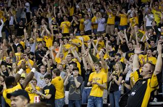 fans cheer in Carver-Hawkeye Arena