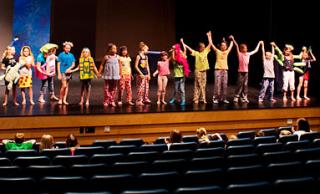 Participants in the Osage Summer Theatre Program finish their dress rehearsal and prepare to take a bow.