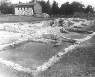 Luther College professor Sigurd Reque's 1940 archaeological excavations at Fort Atkinson, which here exposed the officer's quarters foundation. Standing building is the north barracks.