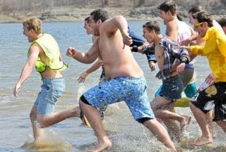 Members of Sigma Chi race into the water during last year's polar plunge.