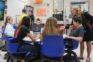 Laura Fernandez, right, connects her students with UI students through Mount Pleasant's new STEM classroom.