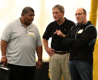 Romeo Crennel, Kirk Ferentz, and Scott Pioli stand at Pro Day