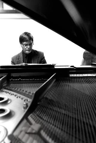 john rapson sitting at piano