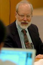 John Reitz sitting in classroom