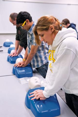 Students participate in hands-on CPR training