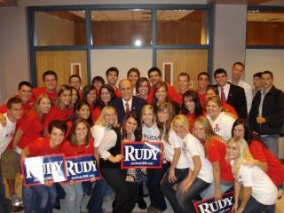 UI students posing with Rudy Giuliani