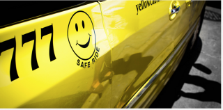 side of SafeRide taxi cab with smiley face