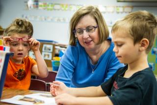 Teacher Sarah Kalsem inspires two students to imagine, create, and discover.
