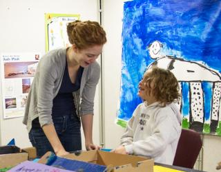 Art Education student teacher engages young artist.