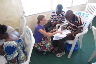 Stephanie Lukas training pharmacy employees in Liberia
