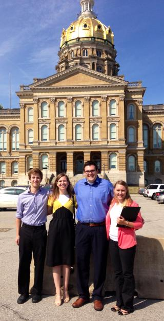 University of Iowa graduate students standing in front of the Iowa State Capitol