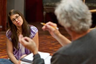 Recent UI graduate Deanna Brookens gets feedback from director Eric Forsythe after a rehearsal of What the Butler Saw