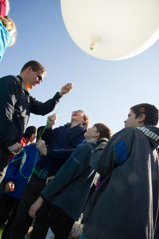 Science Education Professor Ted Neal launches a weather balloon with students in the community.