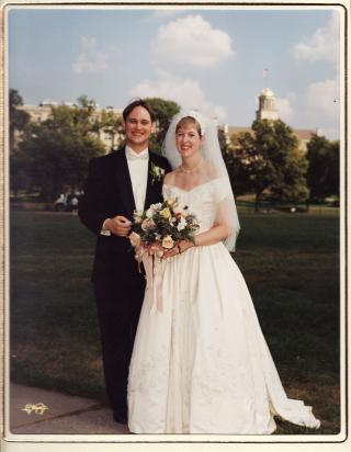 wedding photo of Jason and Alison Tibbetts standing with Old Capitol in the background