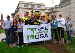 Students with UI mascot Herky and a Tree Campus USA banner