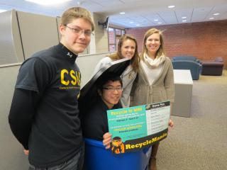 UISG leaders pose with recycle bin