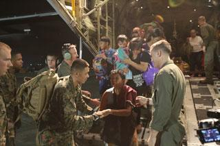U.S. marines help victims of Typhoon Hayan