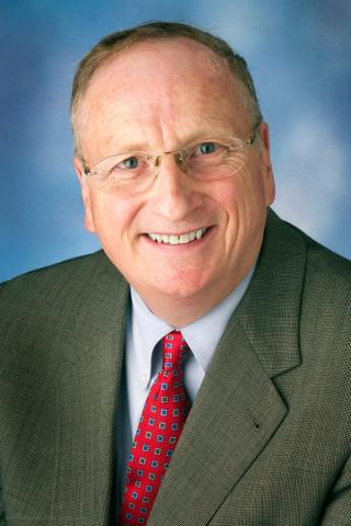 Portrait of Derek Willard.