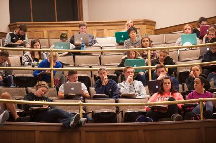 Students listening to lecture in Macbride Auditorium