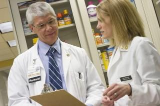 Jeff Reist, RPh ParmD Clinical Pharmacist, with Tara Kilburg, a former graduate student.