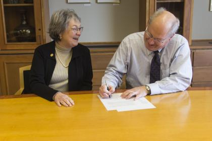Cornell dean and UI Law dean siging the 3+3 agreement