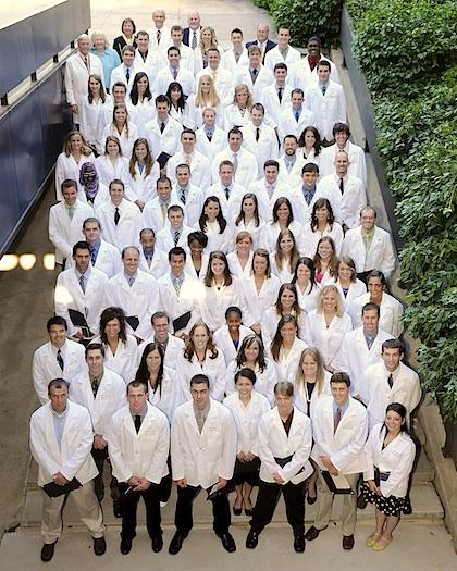 Dental students in white lab coats.