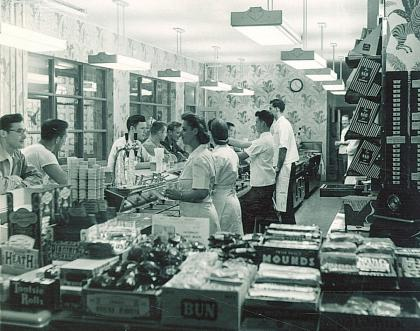 Employees serve students at the counter of the Quadrangle Grill in this 1949 photo.