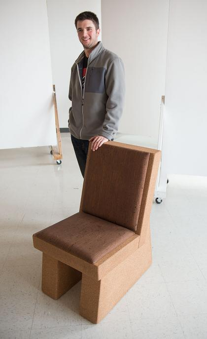 alex zeppieri standing by chair made of cork