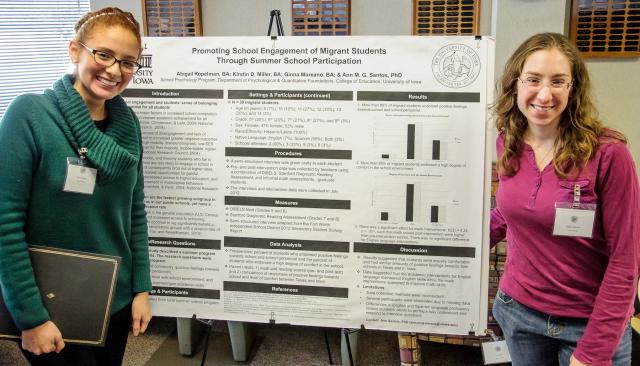 Abigail Kopelman and Ginna Moreano with their research poster.
