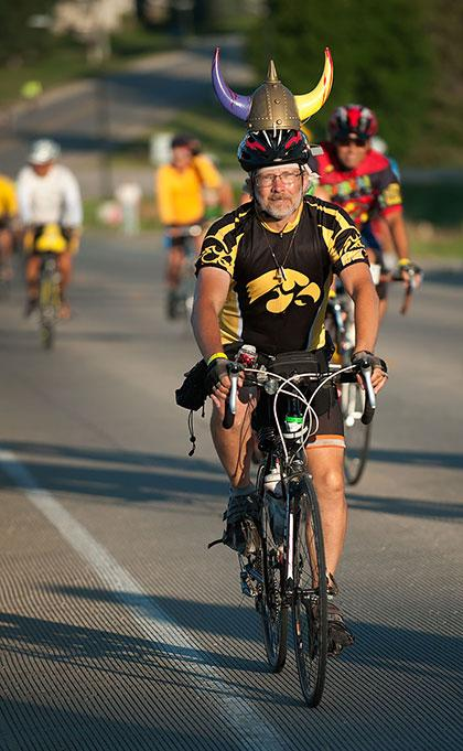 A man wearing an Iowa jersey rides Ragbrai