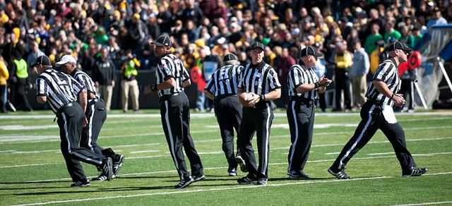 Football officials prepare to start the game