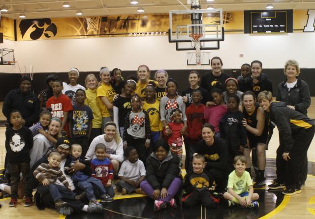 Children with the Iowa women's basketball team