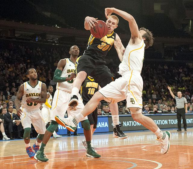 aaron white fights for the ball against baylor