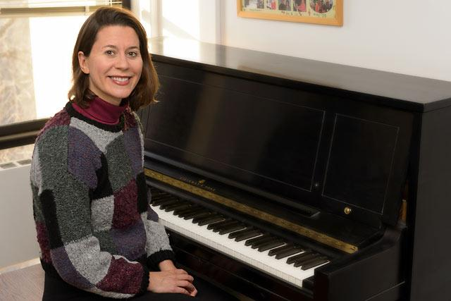 mary cohen sitting before piano