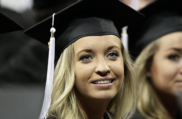student in cap and gown