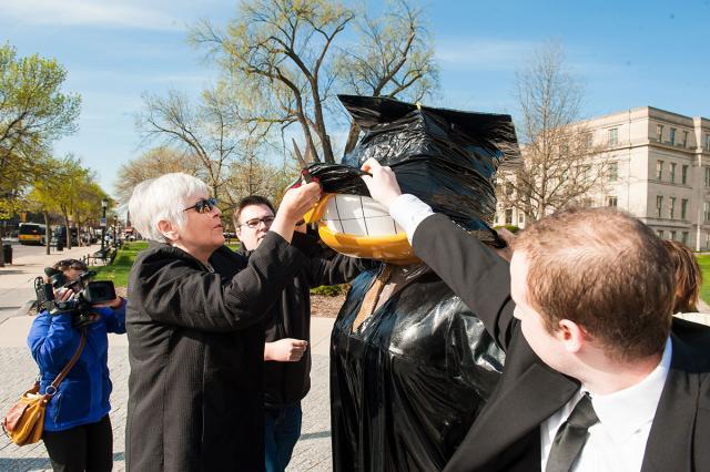 Sally Mason helps with the unveiling of Graduation Herky