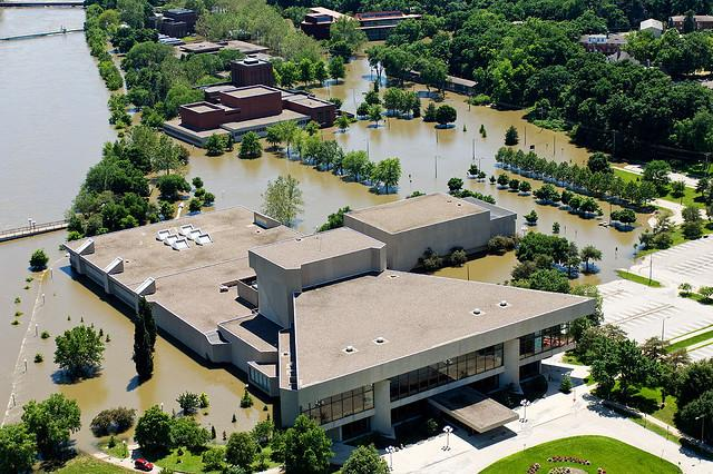 An aerial photo of Hancher and the Voxman Music Building during the flood of 2008