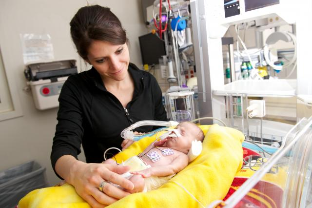 mother with preemie baby in NICU