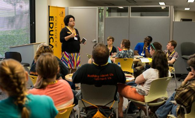 Kendra Malone speaks to a room of participants at the LGBTQ homeless youth summit in the TLC.