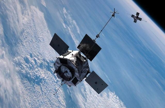 An artist's rendering shows the twin satellites of the Van Allen Probes mission in tandem orbit above the Earth. Image credit: NASA.