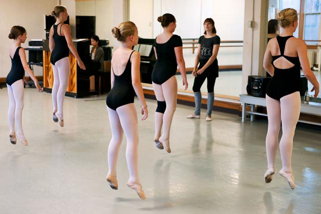 Dancers practice the preparation for a series of traveling turns.