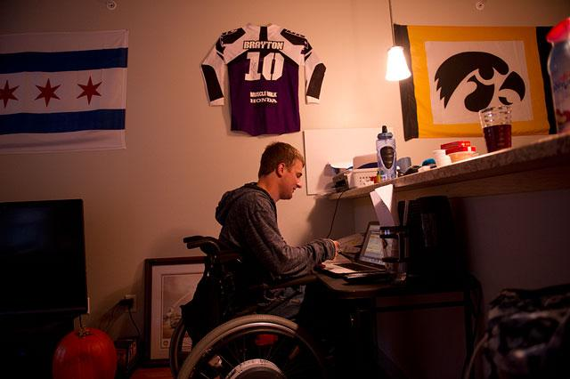 Travis studies in his Iowa City apartment.