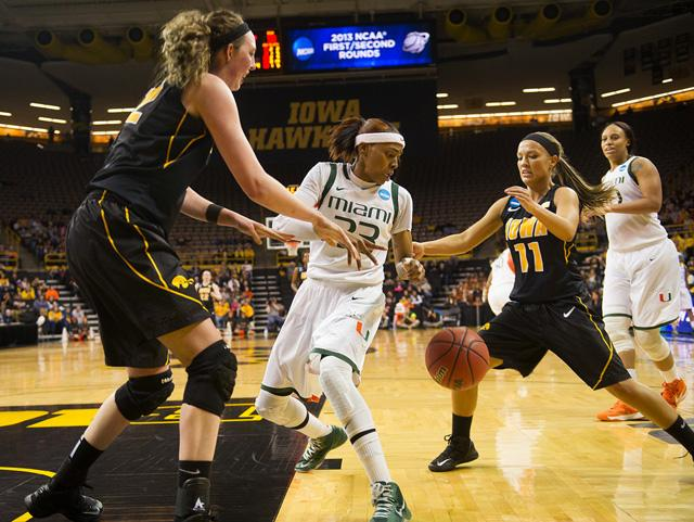 Iowa's Morgan Johnson and Trisha Nesbitt strip the ball from Miami's Suriya McGuire